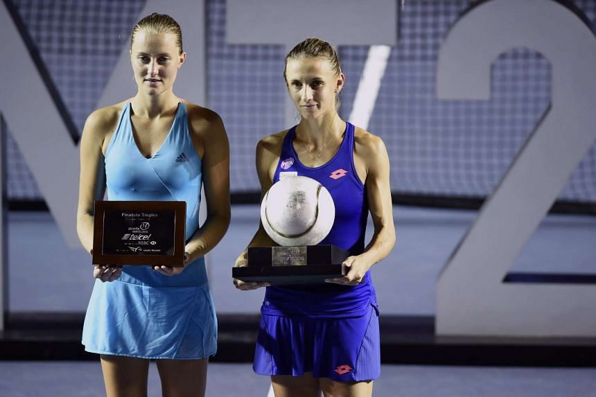 Lesia Tsurenko (right) and Kristina Mladenovic pose after the Mexican Tennis Open WTA final match in Acapulco on March 4, 2017.
