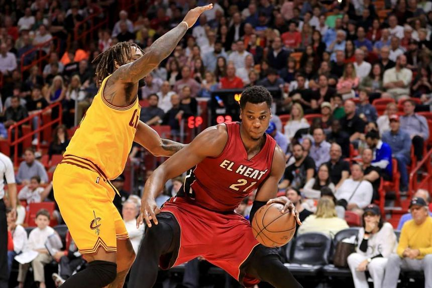 Miami Heat centre Hassan Whiteside (#21) backing down against Cleveland Cavaliers forward Derrick Williams (#3) during their NBA match on March 4, 2017.
