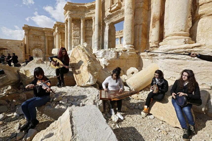 Atop Palmyra S Damaged Theatre Syrian Musicians Sing Of Return