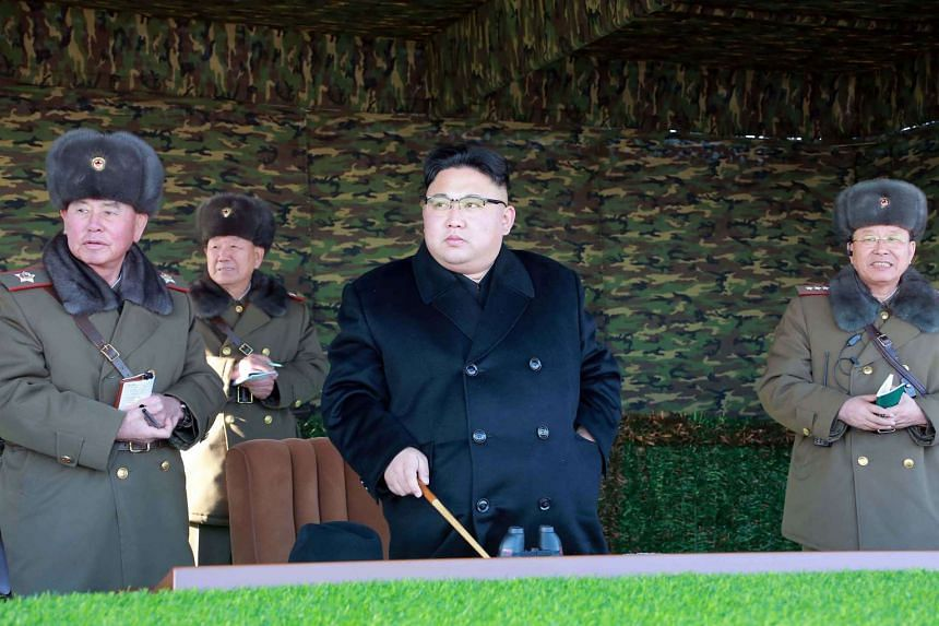 North Korean leader Kim Jong-Un (centre) inspecting a tactical military drill at an undisclosed location in North Korea.