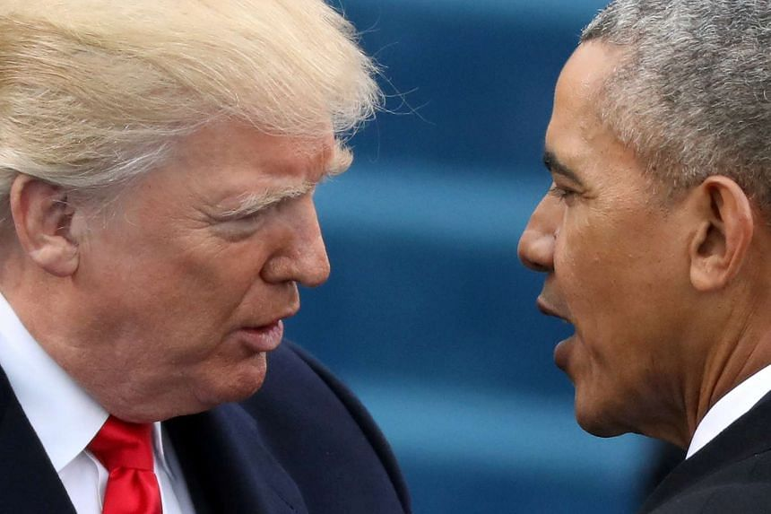 Obama (right) greets Trump on inauguration day on Jan 20, 2017.