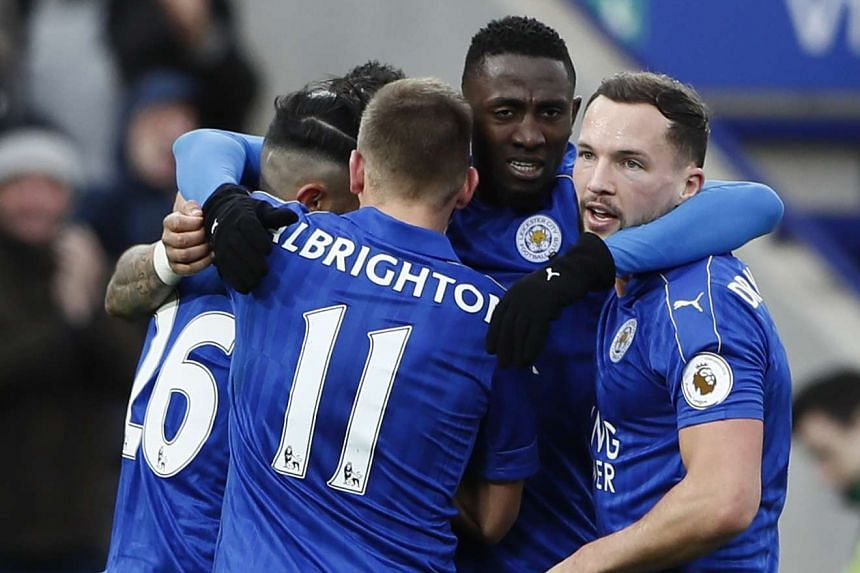 Leicester City's Riyad Mahrez (No. 26) celebrates with teammates after scoring the second goal.