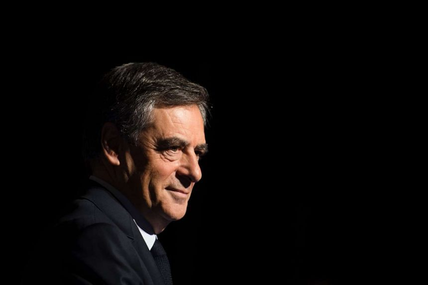 Fillon delivers a speech to present his programme during a campaign meeting in Aubervilliers, outside Paris, on March 4, 2017.