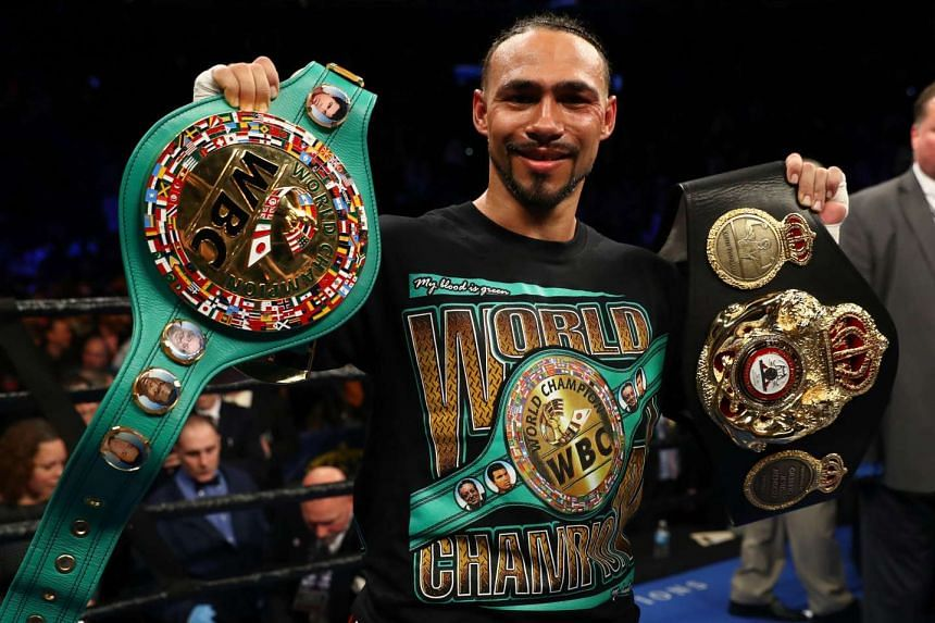 Keith Thurman celebrating his split decision win against Danny Garcia on March 4, 2017.