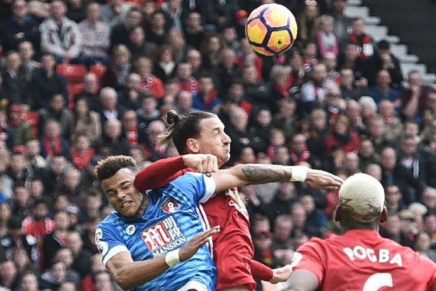 Manchester United striker Zlatan Ibrahimovic (centre) and Bournemouth defender Tyrone Mings going for the ball during their EPL match on March 4, 2017.