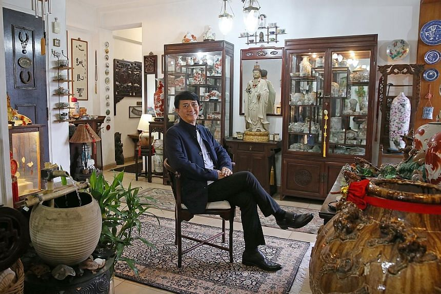 Mr Loo in his Landmark Tower apartment, which is filled with pieces of Chinese artwork and antiques that adorn its corners and walls, giving it an oriental aesthetic. The tower is located near major expressways, Outram Park MRT station, Singapore Gen