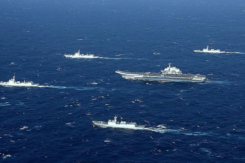 """China's Liaoning aircraft carrier, with an accompanying fleet, conducting a drill in an area of the disputed South China Sea in December last year. Beijing says that the situation in the area is """"calming down"""" as China and Asean countries have return"""