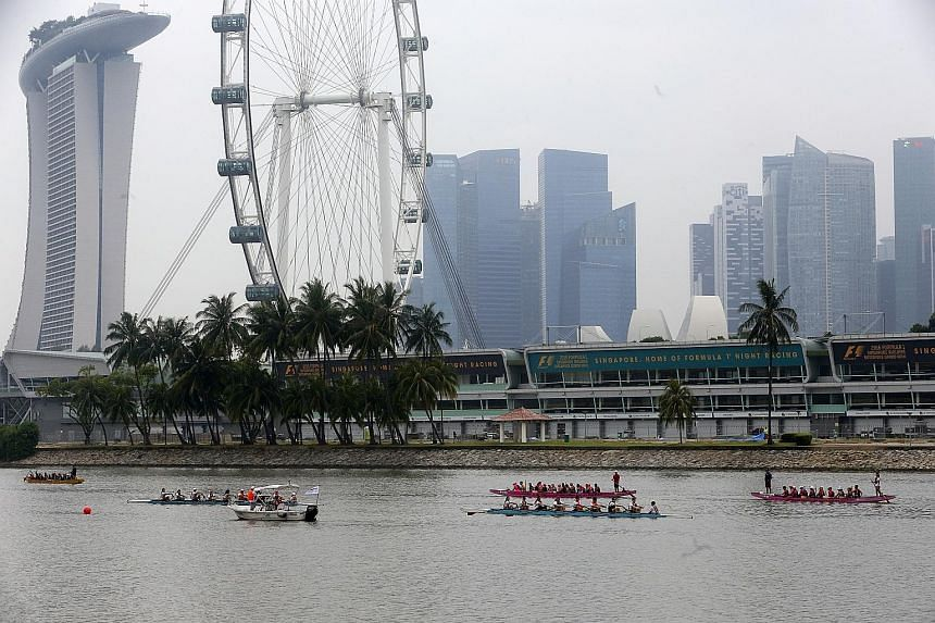 Dragon boaters taking part in a race at the launch of Singapore's month-long celebration of World Water Day at Marina Barrage yesterday. In a Sunday Times poll of 100 respondents, 75 said they did not know how much they spent on water each month.