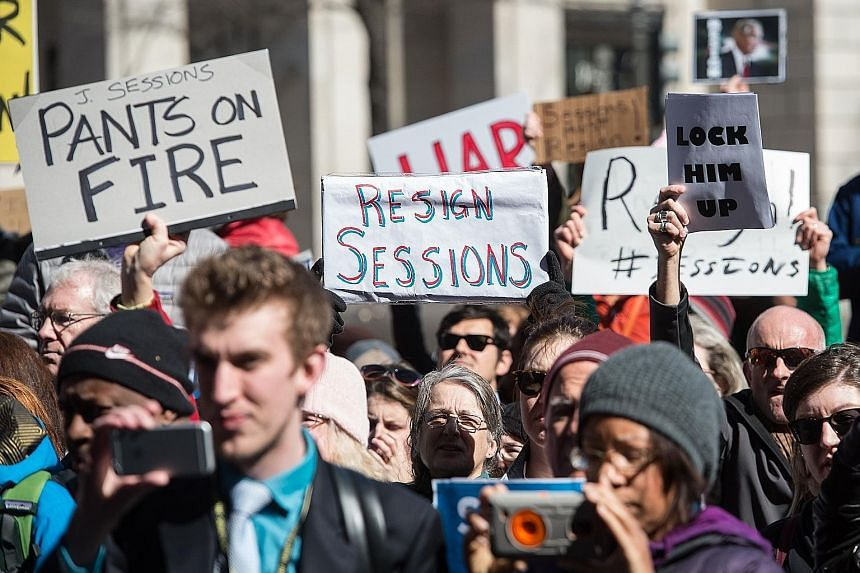 Protesters calling for the resignation of US Attorney-General Jeff Sessions in front of the Justice Department in Washington, DC last Thursday. He came under fire after it was revealed last week that he met Russian Ambassador Sergey Kislyak twice bef