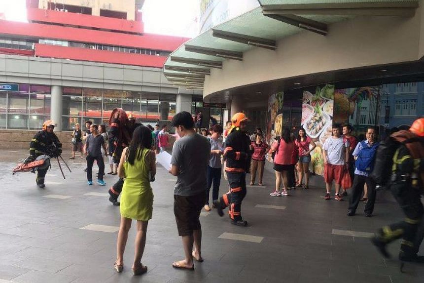 SCDF personnel being deployed at Chinatown Point after a fire broke out on March 5, 2017.