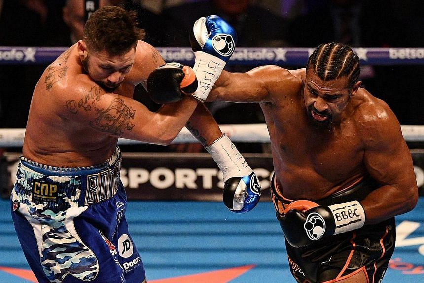 British boxer David Haye (right) unleashes a right cross against compatriot Tony Bellew (left) during their heavyweight boxing match at the O2 Arena in London on March 4, 2017.