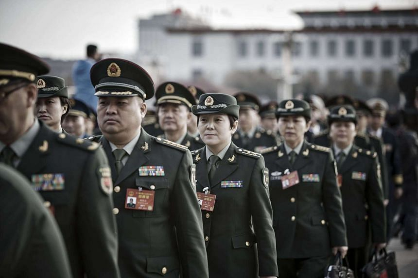 Members of the Chinese People's Liberation Army and military delegates arrive at the Great Hall of the People ahead of the opening of the fifth session of the 12th National People's Congress in Beijing, China.