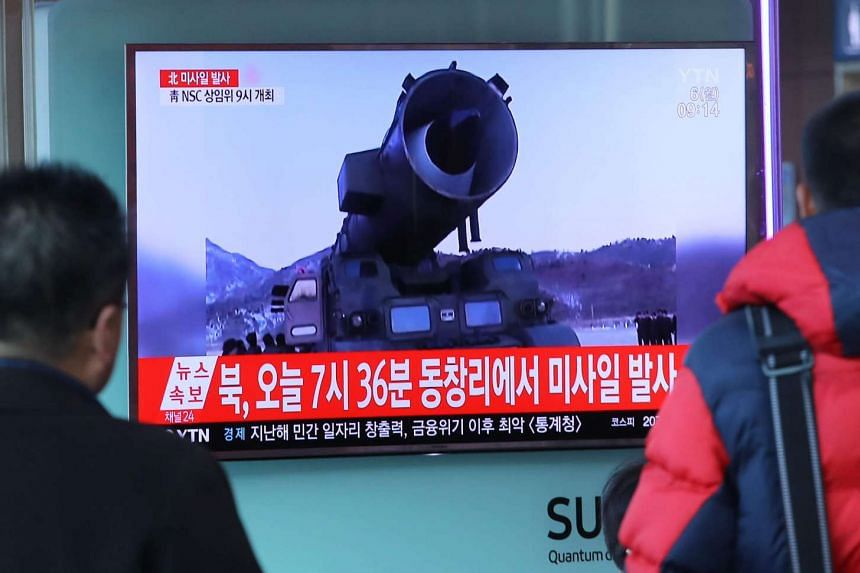 Television news coverage showing archive footage of a North Korean missile launch is broadcast on a public screen in Seoul, on March 6, 2017.