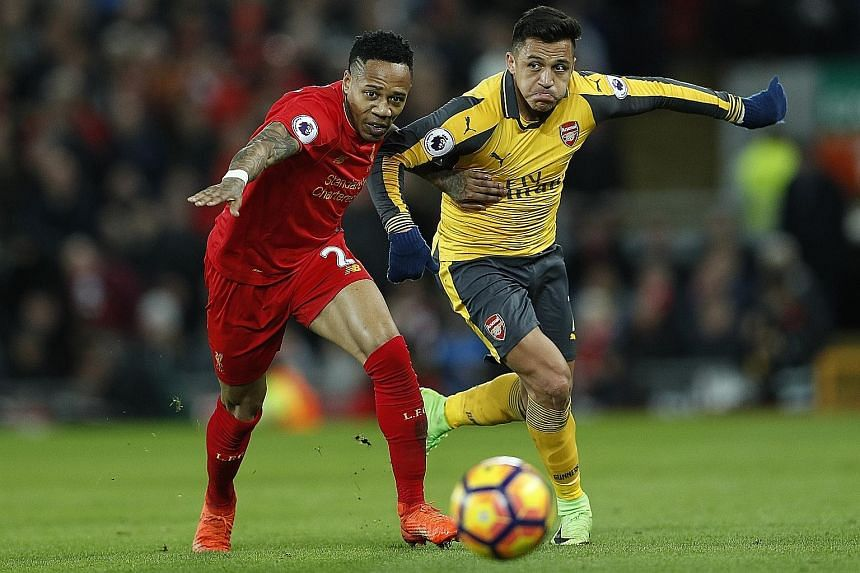 Arsene Wenger's dropping of Alexis Sanchez (right), battling Liverpool's Nathaniel Clyne, from Arsenal's starting line-up on Saturday is bound to raise further questions over the under-fire manager's decision-making.