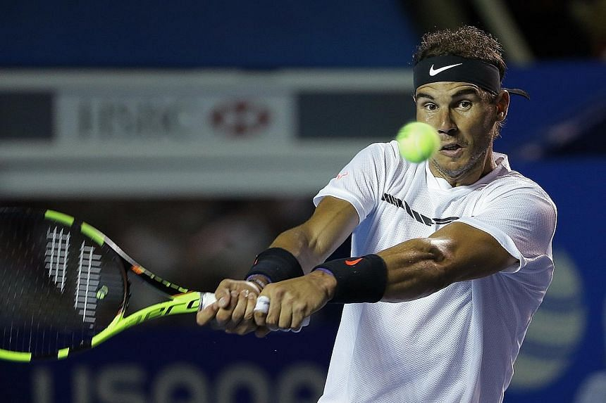 Rafael Nadal hitting a backhand against Sam Querrey in the final of the Mexican Open. The former world No. 1 entered the title decider without dropping a set in his 14 previous matches in Acapulco.