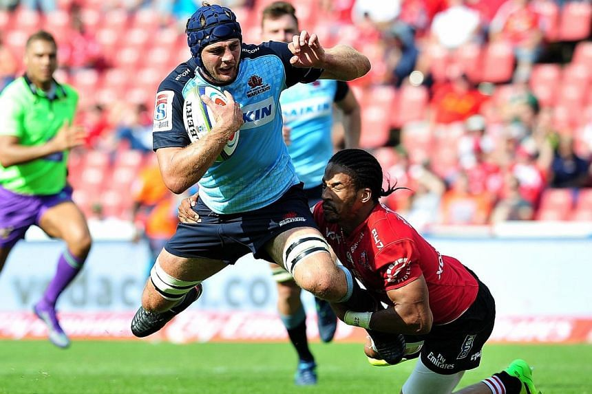Waratahs' Dean Mumm losing out in the tackle to Lions' Courtnall Skosan as the Lions thrashed the Waratahs 55-36 in Johannesburg. Super Rugby is facing calls to drop at least one team.