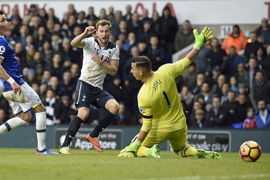 Harry Kane firing past Everton goalkeeper Joel Robles to put Tottenham two up in the second half. The striker's two goals helped keep the north London side second in the league, after surviving two late goals from the Merseysiders.