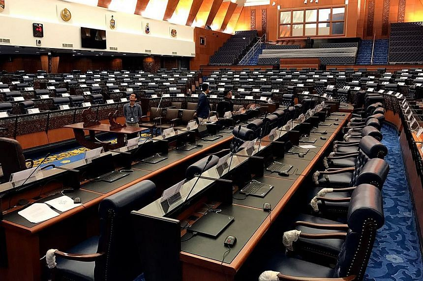 The newly refurbished Dewan Rakyat in Malaysia's Parliament Building. The parliamentary session which begins today is likely to be the final one before the next general election, which many expect to be called this year. Demonstrators at a rally in s