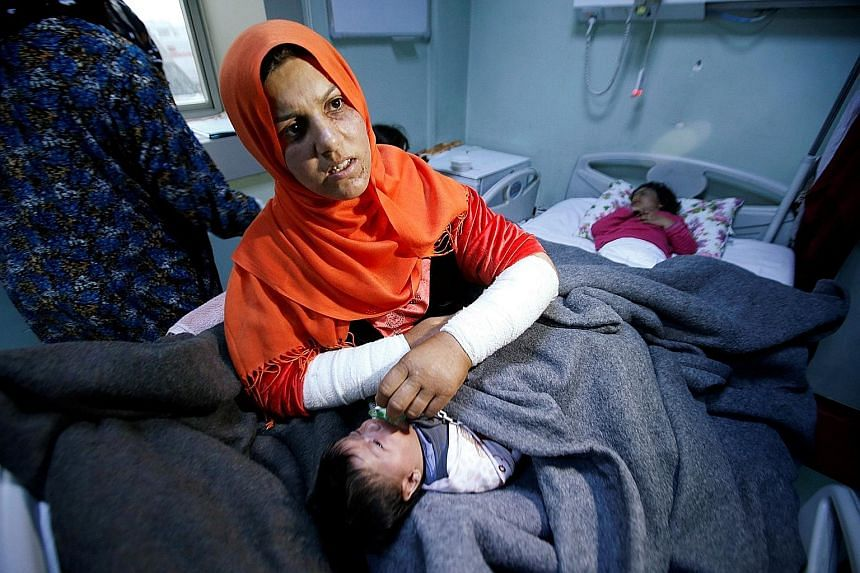 An Iraqi woman whose daughter, Ranmea, is being treated for possible exposure to chemical weapons. Five children are among the 12 people who are showing signs of having been exposed to chemical agents in eastern Mosul, which was recaptured by Iraqi f