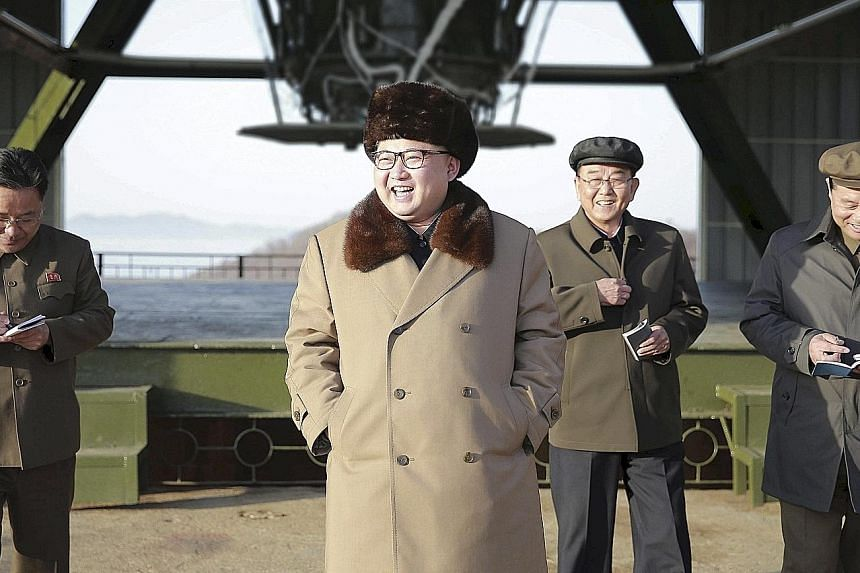 """North Korean leader Kim visiting a missile test centre in North Pyongan province last April. Analysts say the engines behind him could power an intercontinental ballistic missile, for which Mr Kim claimed earlier this year that his country is in """"fin"""
