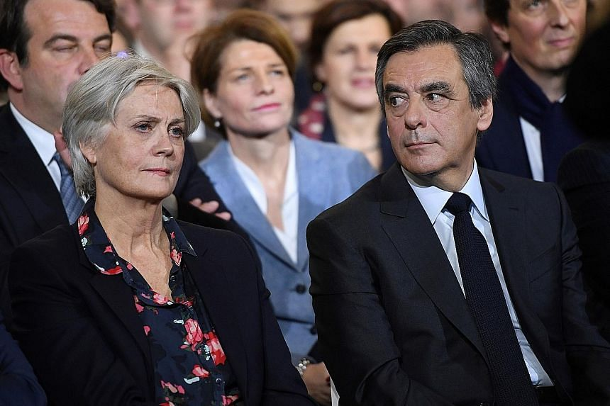 """The pressure is mounting on Mr Fillon and his wife, Penelope, with his party's decision-making body meeting this evening """"to evaluate the situation"""". Last week, police searched Mr Fillon's country home and Paris apartment for evidence."""