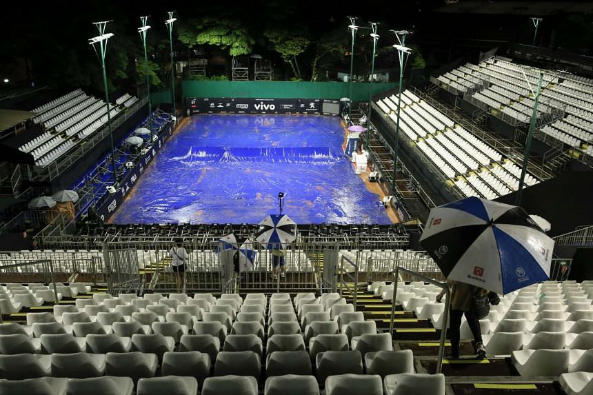 A general view of the tennis court during heavy rain that suspended the final game between Pablo Cuevas of Uruguay and Albert Ramos Vinolas of Spain during their ATP 250 Brazil Open tennis tournament in Sao Paulo, Brazil, on March 5, 2017.