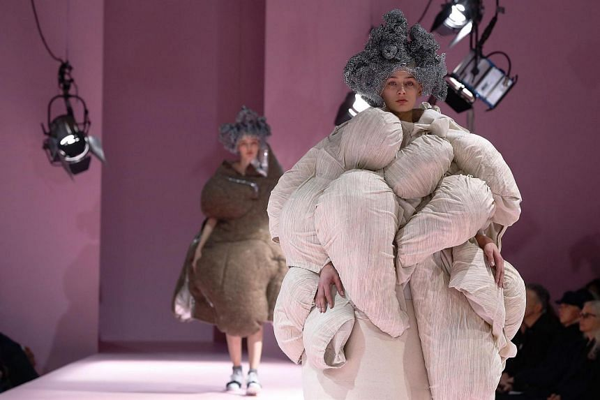Models presenting creations by Comme des Garcons during the women's Fall-Winter 2017-2018 ready-to-wear collection fashion show, on March 4, 2017, in Paris.