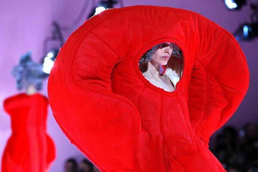 A model presenting a creation by Comme des Garcons during the women's Fall-Winter 2017-2018 ready-to-wear collection fashion show, on March 4, 2017, in Paris.