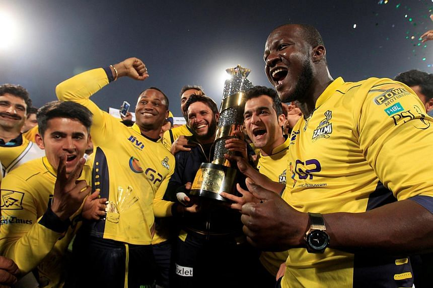 Cricket players of Peshawar Zalmi celebrate their victory over Quetta Gladiators in the final cricket match of the Pakistan Super League (PSL), early March 6, 2017.