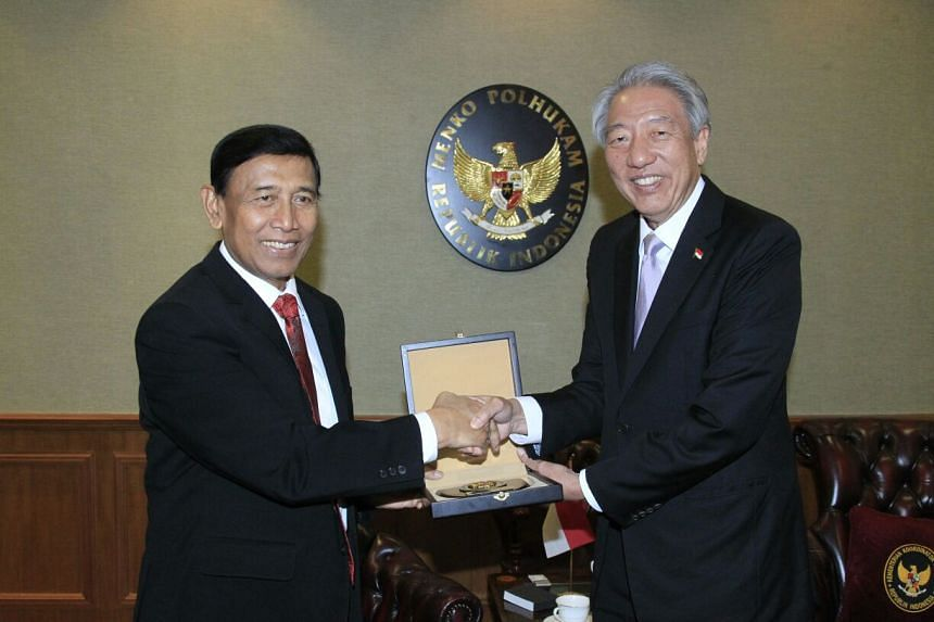 Indonesia's chief security minister Wiranto meeting with Singapore's Deputy Prime Minister Teo Chee Hean in Jakarta.