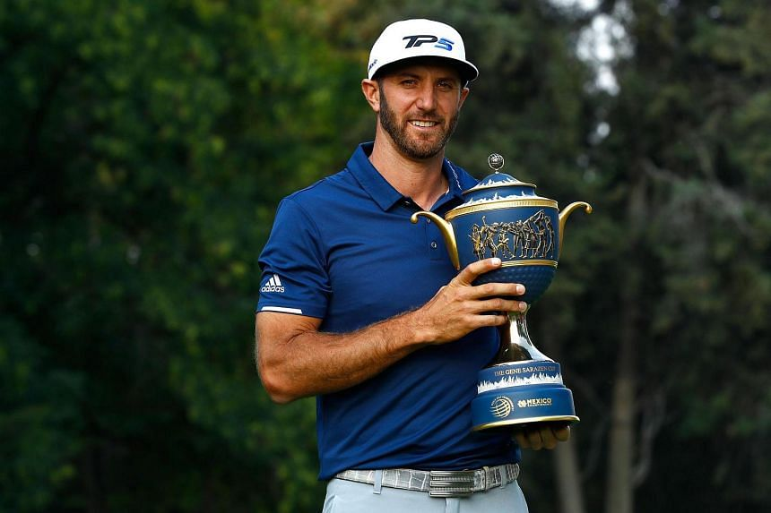 Dustin Johnson of the United States with his trophy after winning the World Golf Championships Mexico Championship at Club De Golf Chapultepec on Sunday (March 5).
