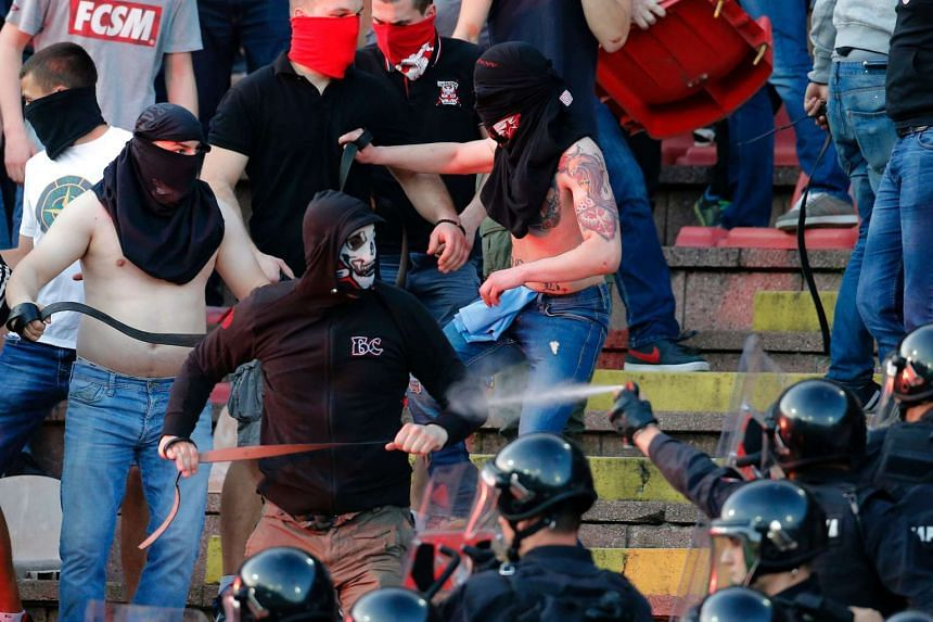 Supporters of Red Star Belgrade clash with police during a Serbian first league match in Belgrade in 2016.