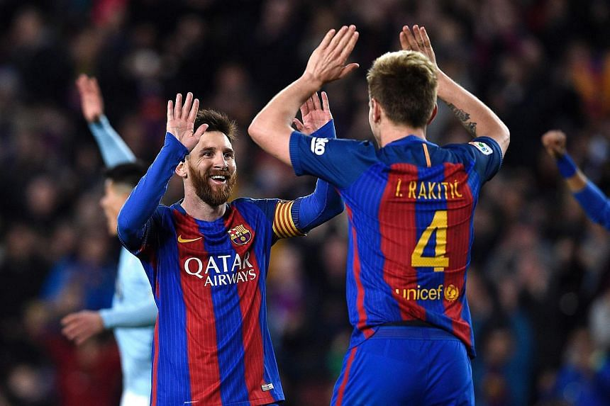 Barcelona's Lionel Messi (left) and Ivan Rakitic celebrating after scoring a goal during the Spanish league football match against RC Celta de Vigo at the Camp Nou stadium in Barcelona on Saturday (March 4).