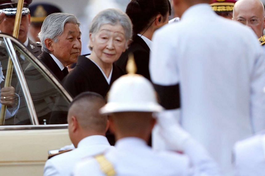 Japanese Emperor Akihito and Empress Michiko, who are in Thailand to mark the 130th anniversary of diplomatic relations between the two countries, were welcomed by the Thai Royal Guards as they arrived to sign a condolence book for Thai King Bhumibol