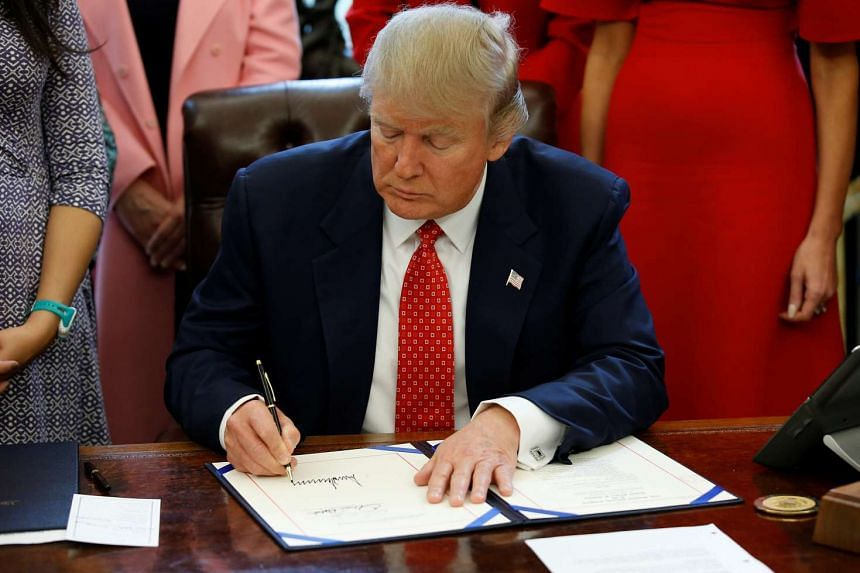 US President Donald Trump signs H.R. 225 in the Oval Office of the White House, in Washington, DC, US, Feb 28, 2017.