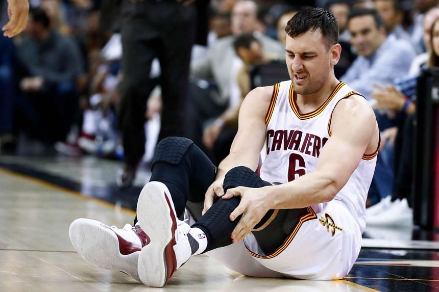 Cleveland Cavaliers centre Andrew Bogut grabbing his leg after injuring it during the NBA match against the Miami Heat on March 6, 2017.