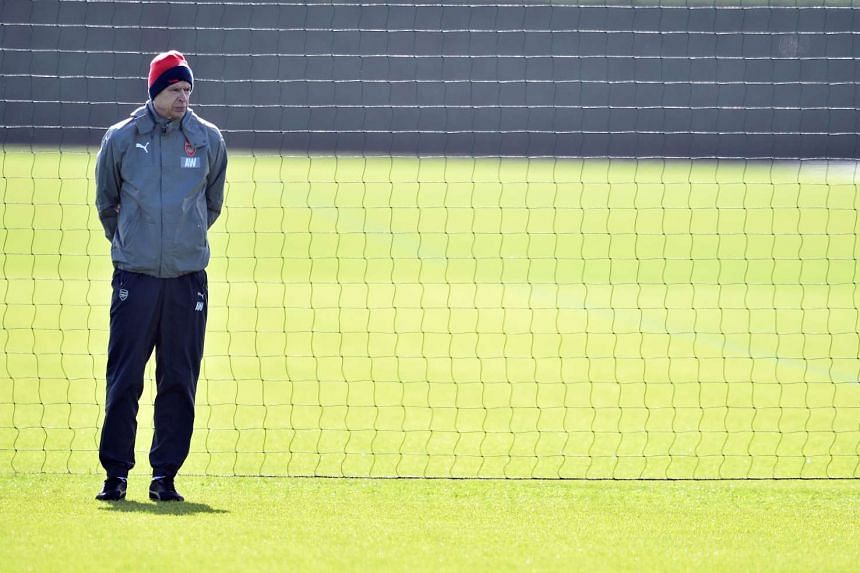 Arsenal manager Arsene Wenger looking on during a training session on March 6, 2017.