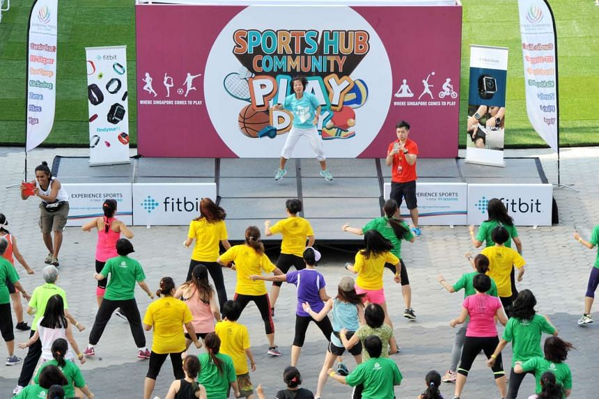 Fitbit trainers conducting the zumba dance workout at the Singapore Sports Hub's community Play Day on June 11, 2016.