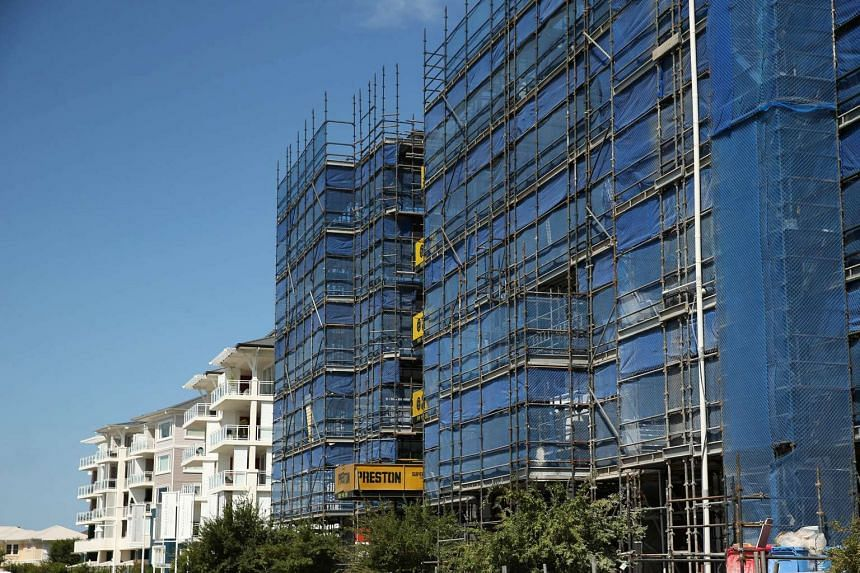 New apartment blocks stand under construction in the suburb of Breakfast Point in Sydney, Australia.