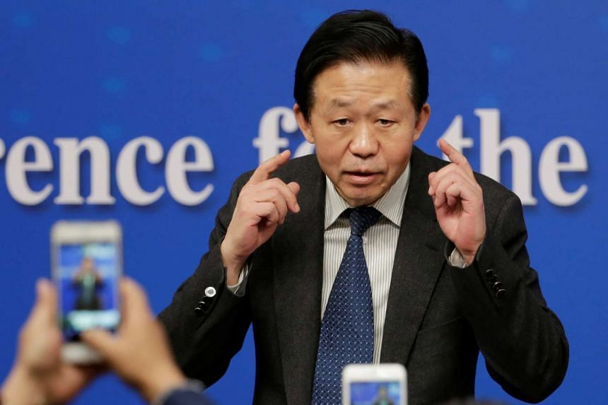 Chinese Finance Minister Xiao Jie speaks to the media after his news conference during the ongoing National People's Congress (NPC), China's parliament, in Beijing China March 7, 2017.
