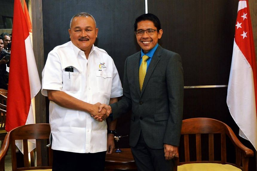 Senior Minister of State for Defence and Foreign Affairs Dr Mohamad Maliki Osman shaking hands with Mr Alex Noerdin, Governor of South Sumatra during a four-day visit to Bandung and Palembang on July 27, 2016.