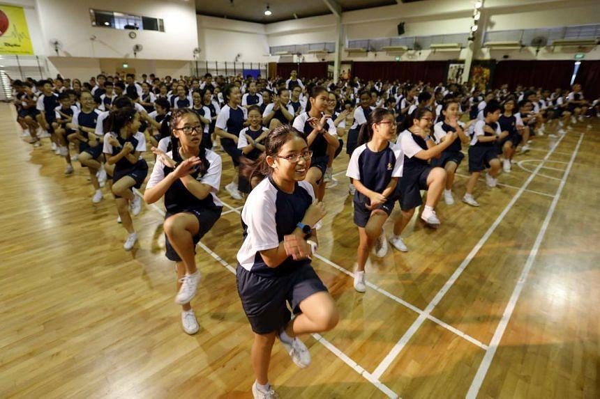 Students from Woodgrove Secondary School enjoying a mass workout.