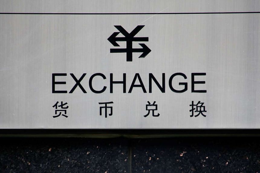 A sign for foreign currency exchange is seen at a branch of the ICBC bank in Beijing, China on Jan 3, 2017.