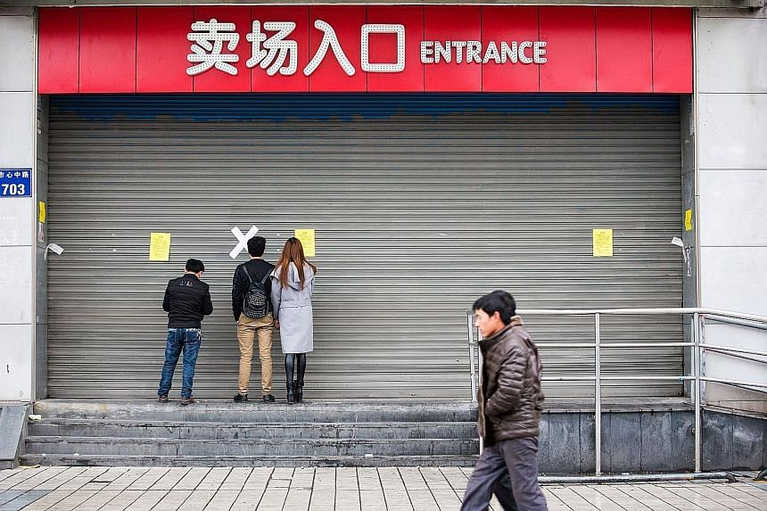 A closed Lotte Mart outlet in Hangzhou, Zhejiang, on Sunday. Although workers at some outlets say the closures were related to fire safety, the shutdowns are seen as the latest in a series of incidents affecting South Korean firms in China because of