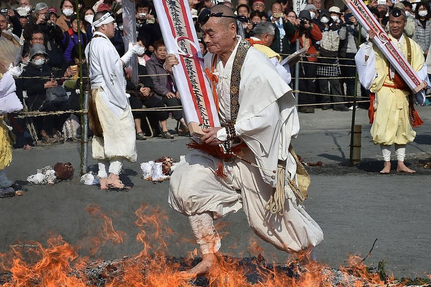 The fire-walking festival known as Nagatoro Hi-Matsuri was marked on Sunday at the Fudoji temple in Nagatoro town, Saitama prefecture, to herald the coming of spring. Hundreds of Buddhist devotees participated in the festival to purify the mind and b