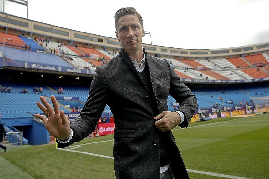 Above: Atletico striker Fernando Torres waving to fans before their match against Valencia at Vicente Calderon Stadium. He is on sick leave after suffering a head injury when he and Deportivo's Alex Bergantinos collided last Thursday. Right: Antoine