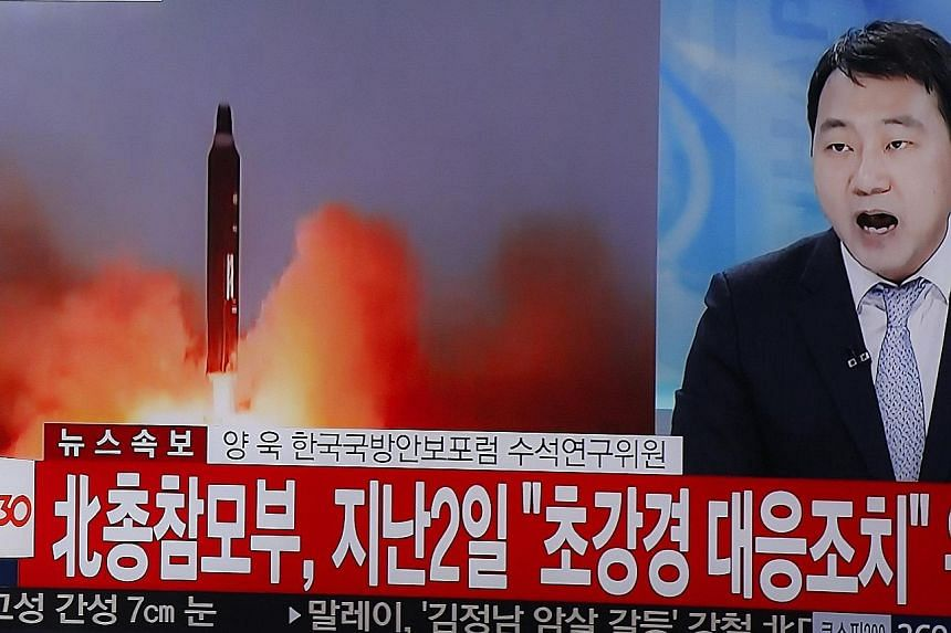 A report on the North Korean missile tests being broadcast on TV in Seoul yesterday. The North's ally China slammed the tests but also put part of the blame on US-South Korea drills that began last week.