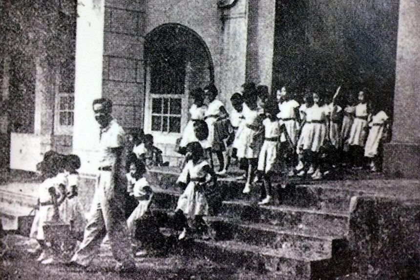 The school in Chinatown in the 1950s. Above: Dr Ho Nai Kiong, a retired paediatrician and former student of Yeung Ching School, started researching for his book, Records Of Old Yeung Ching, in 2005.