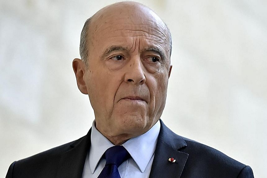 """Mr Fillon and his wife, Penelope, at Sunday's rally in Paris. Buoyed by the tens of thousands of supporters, Mr Fillion has declared that """"no one today can prevent me being a candidate"""". Mr Juppe was considered too soft on social issues for Mr Fillon"""