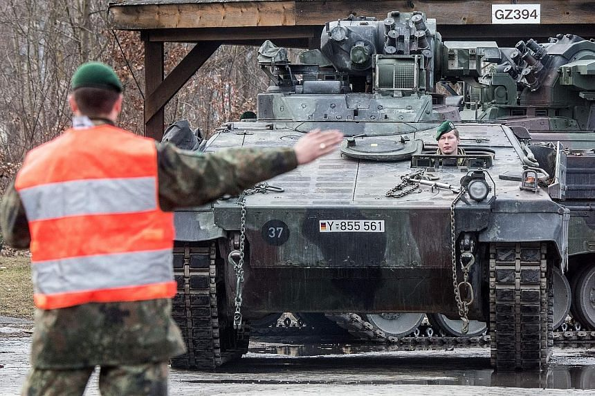 """Nearly 500 German troops are in Lithuania on an open-ended Nato deployment near the Russian frontier. While Pro-Russian websites are calling the deployment a """"second invasion"""" by Germany, the Nazis are ancient history to Lithuanians, who are now more"""